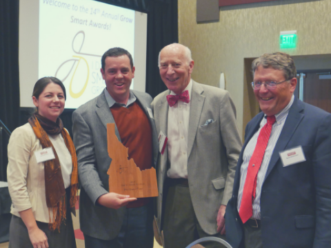 Paddy Tillet with Grove Plaza award recipients